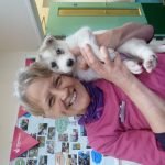 Fiona from Rock View Vets having well-earned puppy cuddles!